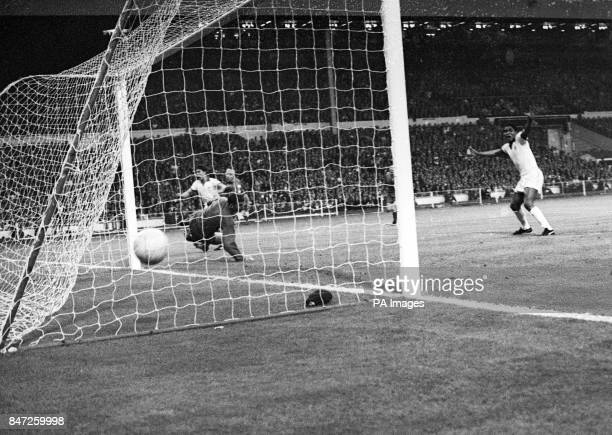 Manchester United goalkeeper Alex Stepney dives but the ball skims into the net for Benfica's goal scored by their No6 Jaime Graca in the European...