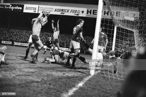 Manchester United goalkeeper Alex Stepney dives in vain as Norwich City's Colin Suggett nets the goal which proved decisive Norwich's David Stringer...
