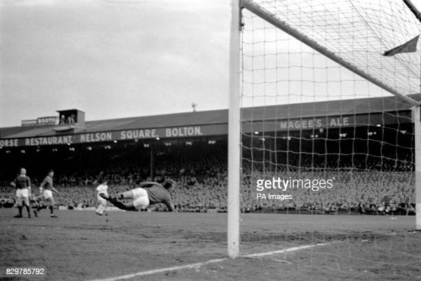 Manchester United goalkeeper Alex Stepney dives in vain as the winning goal scored by Leeds United's Billy Bremner flies into the net