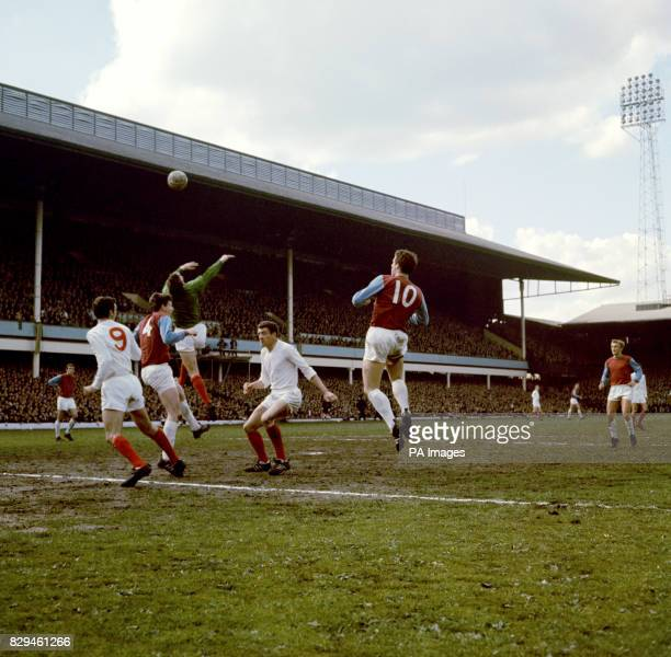 Manchester United goalkeeper Alex Stepney flaps at a cross watched by teammates David Sadler and Bill Foulkes and West Ham United's Martin Peters and...