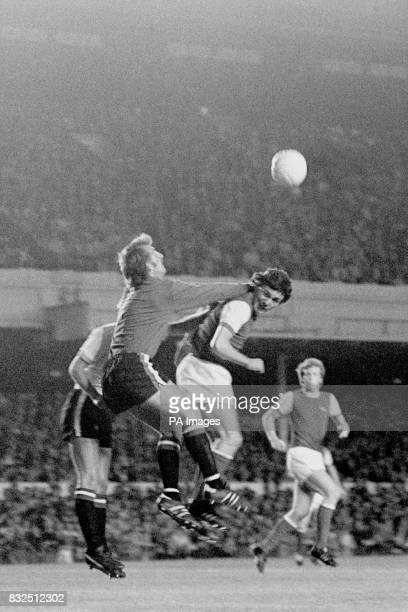 Manchester United goalkeeper Alex Stepney punches clear from Arsenal's Frank Stapleton