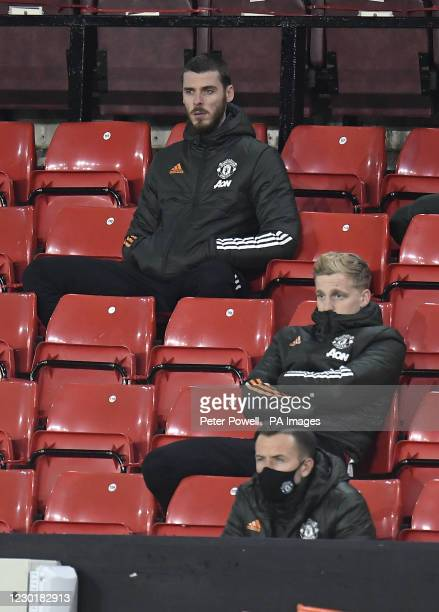 Manchester United goalkeeper David de Gea and Donny van de Beek sit on the bench during the Premier League match at Bramall Lane, Sheffield.