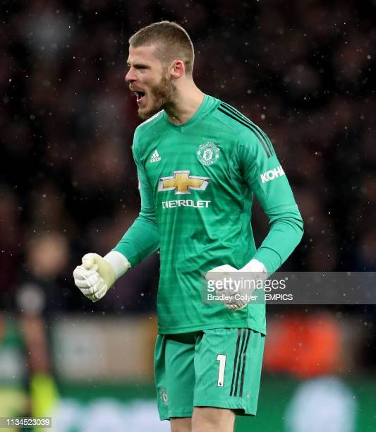 Manchester United goalkeeper David de Gea celebrates his side's first goal of the game scored by Scott McTominay Wolverhampton Wanderers v Manchester...