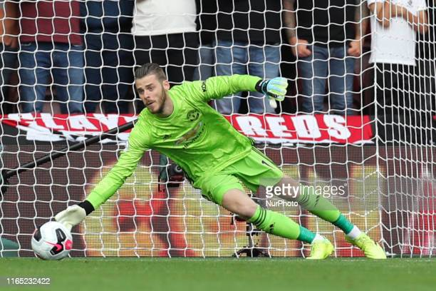 Manchester United goalkeeper David De Gea dives for a save during the Premier League match between Southampton and Manchester United at St Mary's...