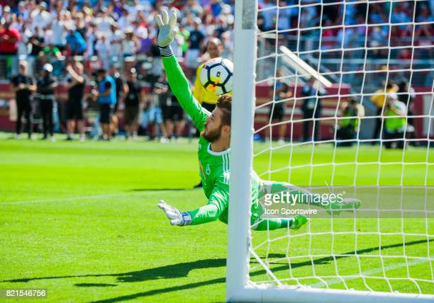 Manchester United goalkeeper David De Gea lungs towards the ball during the kick off at the end of regulation during the International Champions Cup...