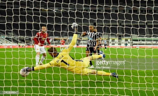 Manchester United goalkeeper David de Gea makes a superb save from a shot from Callum Wilson during the Premier League match between Newcastle United...