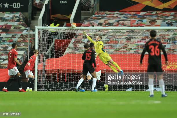 Manchester United goalkeeper Dean Henderson dives for the ball as Sociedad hits the bar during the UEFA Europa League Round of 32 Leg Two match...