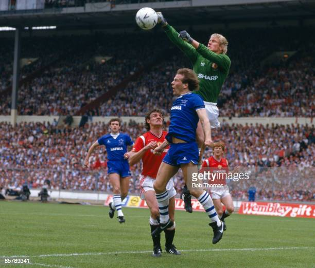Manchester United goalkeeper Gary Bailey jumps above Everton striker Andy Gray to punch the ball away during the FA Cup Final at Wembley Stadium 18th...