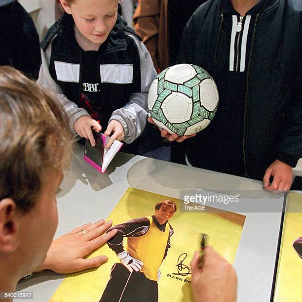 Manchester United goalkeeper Mark Bosnich signs autographs for fans who waited for over 45 minutes in the queue at the International Soccer Expo...