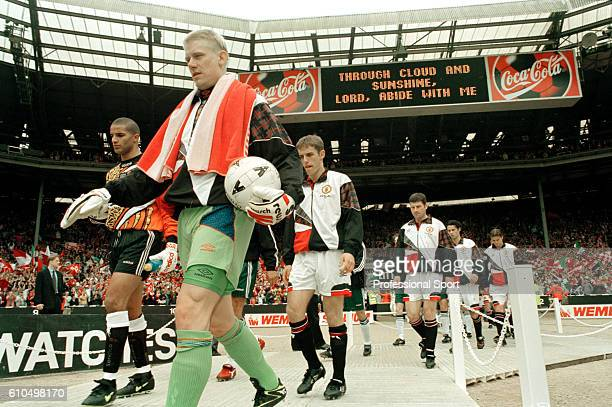 Manchester United goalkeeper Peter Schmeichel walking onto the the field prior to the FA Cup Final between Manchester United and Liverpool at Wembley...