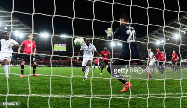 Manchester United goalkeeper Sergio Romero makes a point blank save from Leroy Fer of Swansea during the Carabao Cup Fourth Round match between...