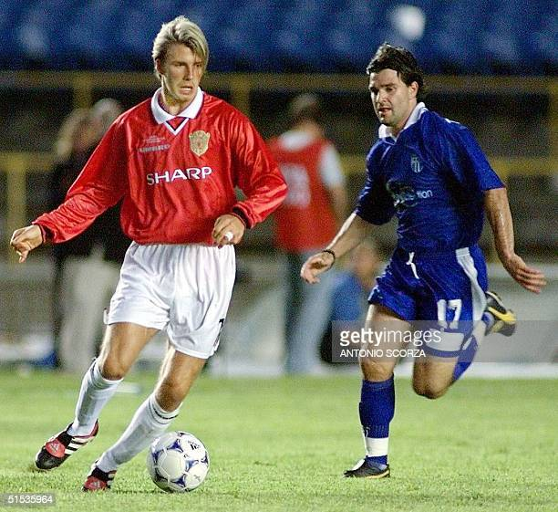 Manchester United golden boy David Beckham moved the ball past Jim Tsekinis of South Melbourne during their World Club Championship match 11 January...