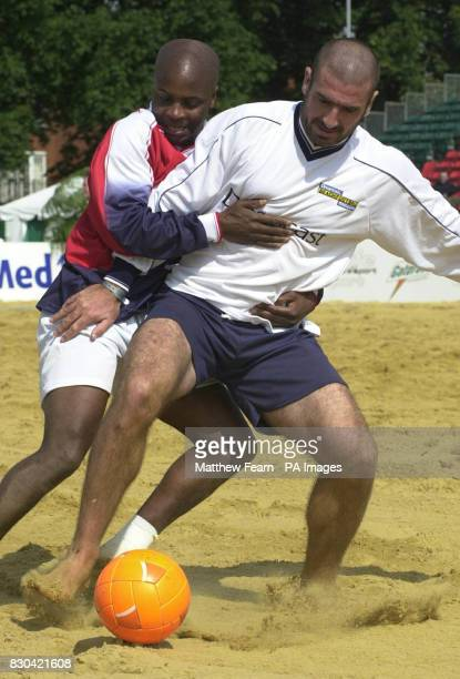 Manchester United Greats' Paul Parker gets to grips with former teammate Eric Cantona during the Dreamcast Beach Football Challenge at the Richmond...