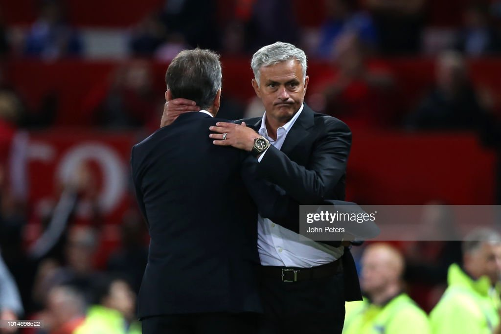 Manchester United Head Coach / Manager Jose Mourinho embraces Leicester City Head Coach / Manager Claude Puel at the end of the Premier League match between Manchester United and Leicester City at Old Trafford on August 10, 2018 in Manchester, United Kingdom.