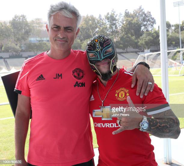 Manchester United Head Coach / Manager Jose Mourinho poses with wrestler Rey Mysterio during a Manchester United preseason training session at UCLA...
