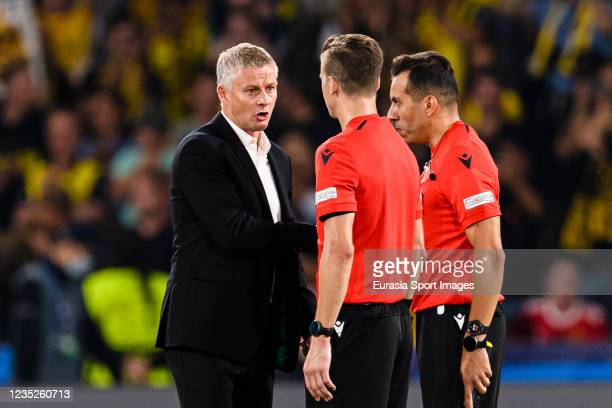 Manchester United Head Coach Ole Gunnar Solskaer talks to Referee François Letexier during the UEFA Champions League group F match between BSC Young...