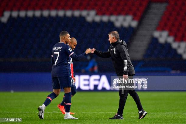 Manchester United head coach Ole Gunnar Solskjaer congratulates Kylian Mbappe of Paris SaintGermain after the UEFA Champions League Group H stage...