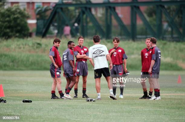 Manchester United in their first day of training Assistant manager Brian Kidd talks to players left to right Andrei Kanchelskis Paul Parker David...