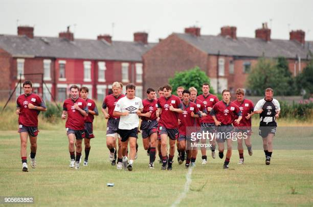 Manchester United in their first day of training Left to right Eric Cantona Brian McClair Gary Neville Peter Schmeichel Assistant manager Brian Kidd...