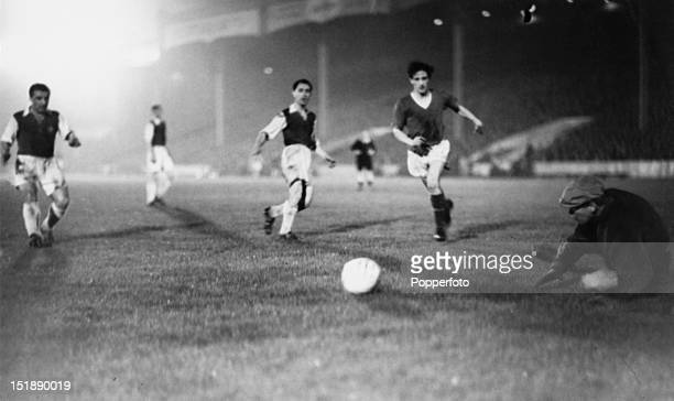Manchester United inside forward Dennis Viollet scores his fourth goal against Anderlecht during the European Champions Cup Preliminary Round second...