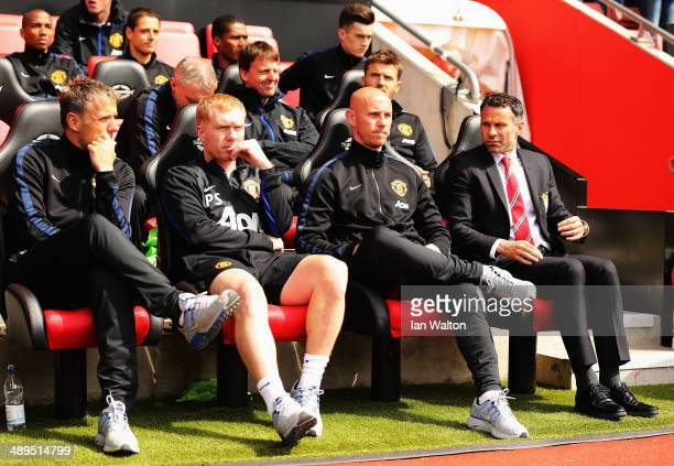 Manchester United interim manager Ryan Giggs looks on alongside assistants Nicky Butt Paul Scholes and Phil Neville before the Barclays Premier...