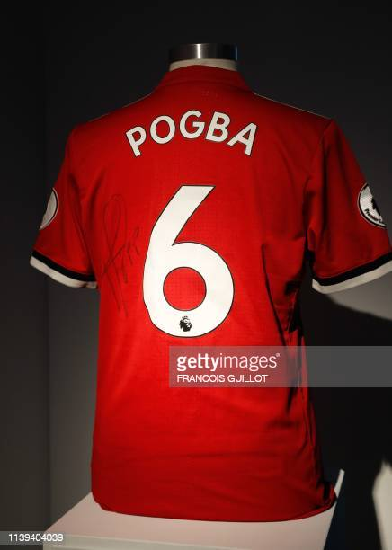 Manchester United jersey worn by French midfielder Paul Pogba on August 13, 2017 against West Ham during the first day of the English championship is...