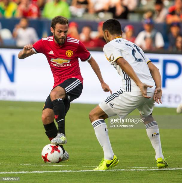 Manchester United Juan Mata moves the ball against Los Angeles Galaxy's Hugo Arellano during the second half of a national friendly soccer game at...