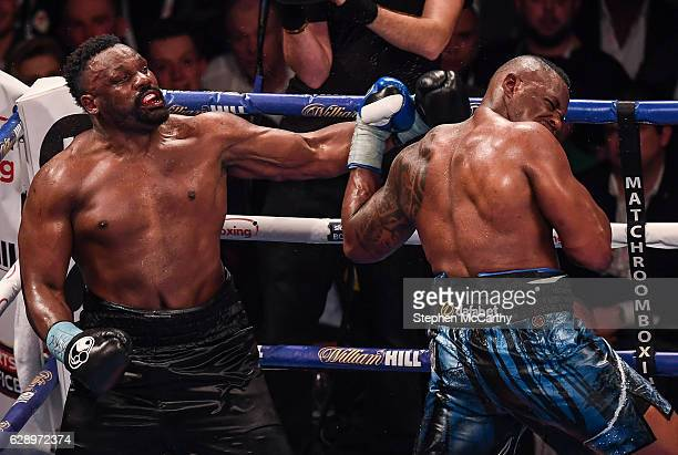 Manchester United Kingdom 10 December 2016 Dereck Chisora left exchanges punches with Dillan Whyte during their WBC World Heavyweight Title...
