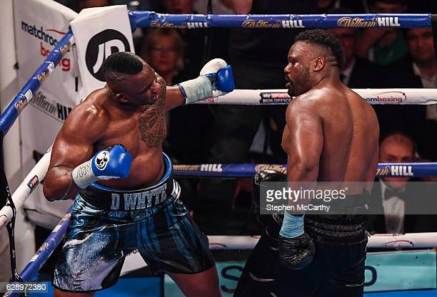 Manchester United Kingdom 10 December 2016 Dillan Whyte left exchanges punches with Dereck Chisora during their WBC World Heavyweight Title...