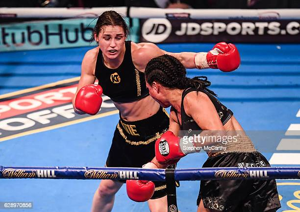 Manchester United Kingdom 10 December 2016 Katie Taylor left exchanges punches with Viviane Obenauf during their SuperFeatherweight fight at the...