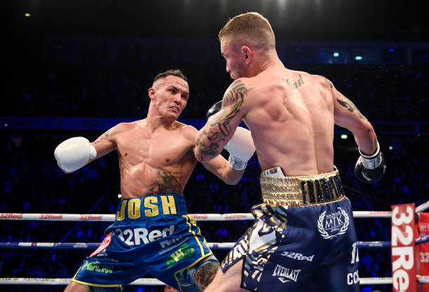 Manchester , United Kingdom - 22 December 2018; Josh Warrington, left, in action against Carl Frampton during their IBF World Featherweight title...