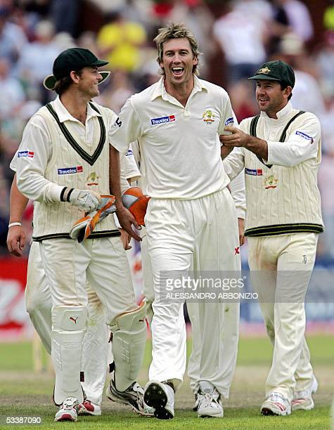 Australian fast bowler Glenn McGrath is congratulated by teammates Adam Gilchrist and Ricky Ponting after he dismissed England's Andrew Flintoff on...