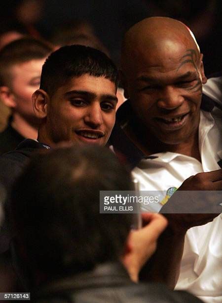 British boxer Amir Khan poses with referee former heavyweight world champ Mike Tyson before a fight in the World Cage Fight Championships in...