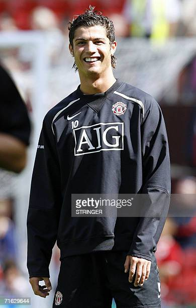 Cristiano Ronaldo in relaxed mood during Manchester United's open training session at Old Trafford in Manchester 11 August 2006 AFP PHOTO/ANDREW YATES