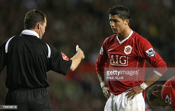 Manchester, UNITED KINGDOM: Cristiano Ronaldo of Manchester United listens to referee Rob Styles during their English Premiership football match...