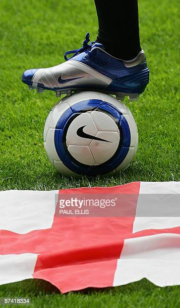 England and Manchester United soccer player Wayne Rooney displays the boots that he will wear during this summer's World Cup in Germany at a...