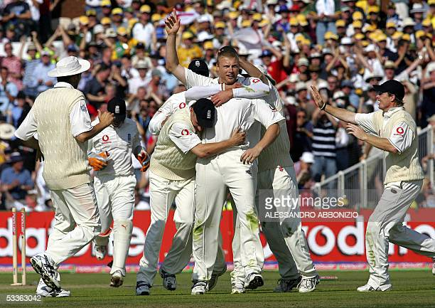 Manchester, UNITED KINGDOM: England players gather to congratulate bowler Andrew Flintoff after he dismissed Australian batsman Simon Katich on the...