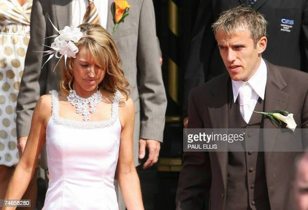 Everton and England footballer Phil Neville and his wife Julie Killilea Neville leave Manchester's Cathedral north west England 16 June 2007 after...