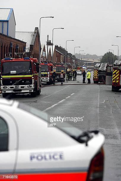 Fire crews and police work at an industrial estate on Broughton Road East Salford Manchester 13 August 2006 after an HGV tanker exploded igniting a...