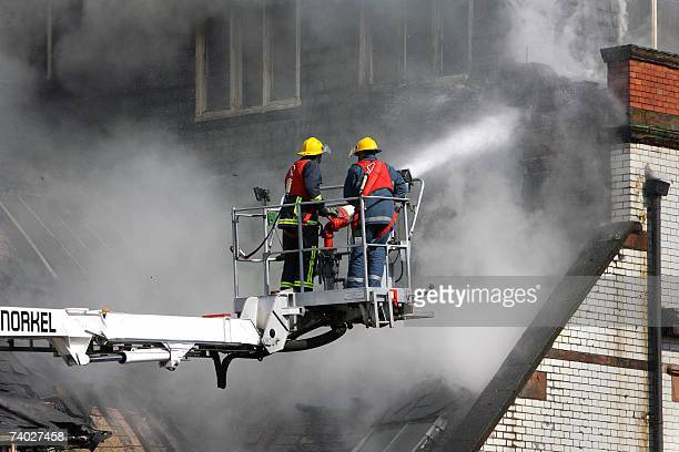 Firemen try to extinguish a fire at a building in the city centre of Manchester north west England 30 April 2007 The fivestorey office block in...