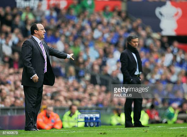 Liverpool manager Rapael Benitez instructs his team as Chelsea manager Jose Mourinho looks on during an FA Cup semifinal game at Old Trafford in...