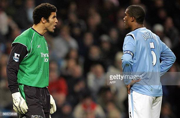 Manchester City goalkeeper David James argues with captain Sylvain Distin after Tottenham Hotspur's Mido scored during their English Premiership...