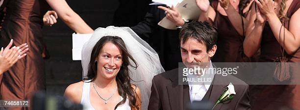 Manchester United and England footballer Gary Neville and his wife Emma Hadfield leave Manchester's Cathedral north west England 16 June 2007 after...