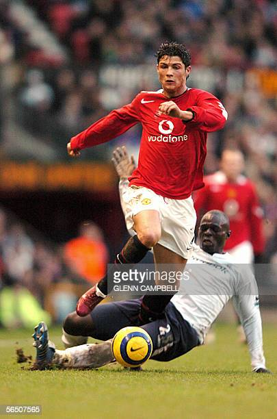Manchester United's Cristiano Ronaldo is tackled by Bolton Wanderer's defence Abdoulaye Faye during the first half of the English Premiership match...