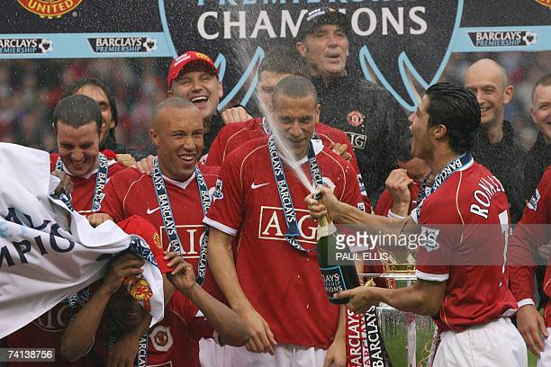 Manchester United's Cristiano Ronaldo sprays the team with champagne after lifting the English Premiership trophy after today's football match at Old...