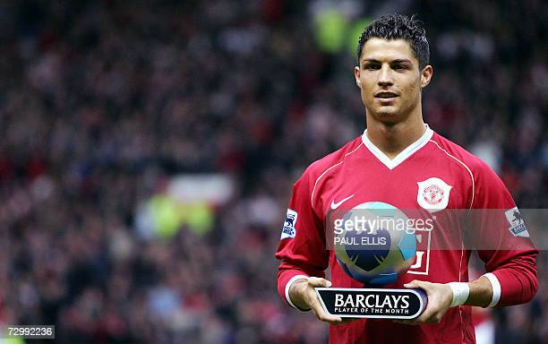 Manchester United's Portugese midfielder Cristiano Ronaldo receives the Premiership player of the month award before the English Premiership football...
