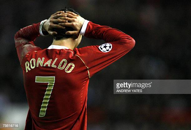 Manchester United's Portugese midfielder Cristiano Ronaldo holds his head against Lille during their UEFA Champions League first knockout round...