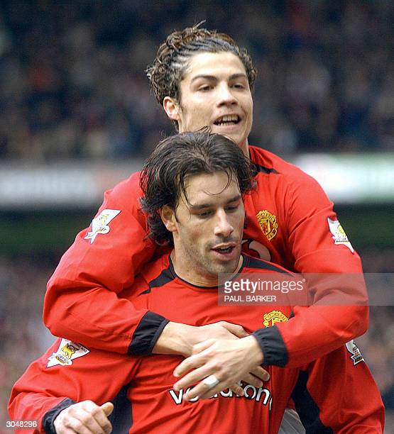 Manchester United's Ruud van Nistelrooy celebrates with Christian Ronaldo after Van Nistelrooy scored his second goal against Fulham during their FA...