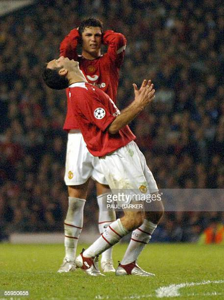 Manchester United's Ryan Giggs and teammate Cristiano Ronaldo cringe after a missed free kick against Lille during tonights UEFA Champions league...