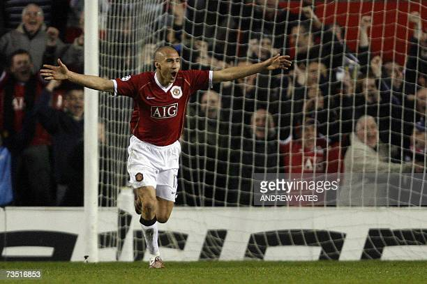 Manchester United's Swedish forward Henrik Larsson celebrates scoring against Lille during their UEFA Champions League first knockout round second...